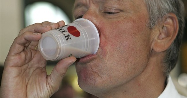 Governor awash in controversy over 25-cent cups of milk