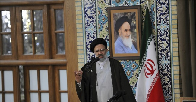 Hard-line cleric says he'll run in Iran election