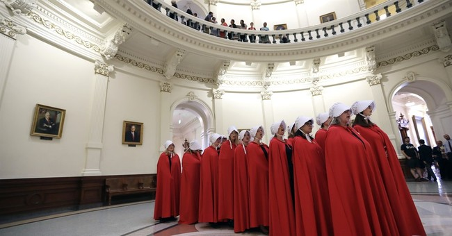 Planned Parenthood Supporters Take a 'Handmaids Tale' Protest to Capitol Hill