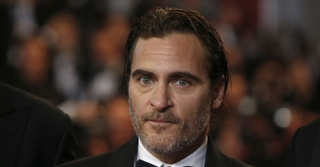 Joaquin Phoenix 'Can't Avoid Flying' But Wants Everyone to Stop Eating Meat to Fight Climate Change
