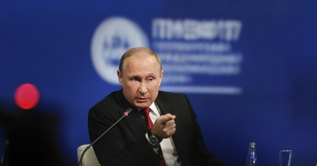 As Trump White House Mulls Invoking Executive Privilege, Putin Says U.S. Hackers May Have Framed Russia