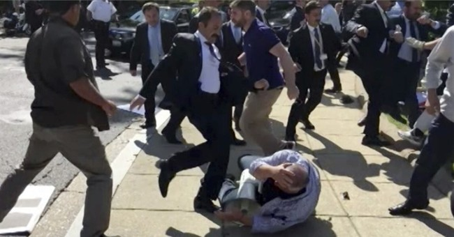 Turkish Guards in Erdogan's Security Detail to Face Charges Over Attack on Protestors