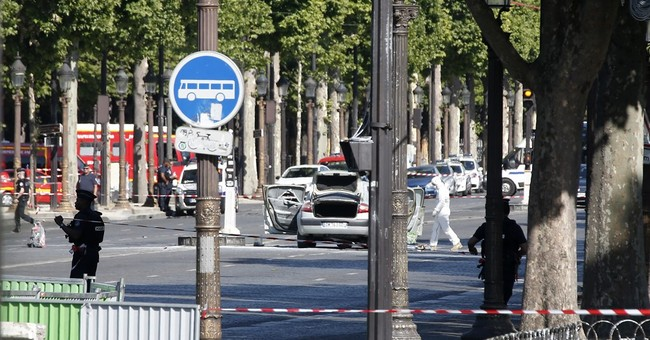 Explosives laden vehicle rams into police van on Champs-Elysees