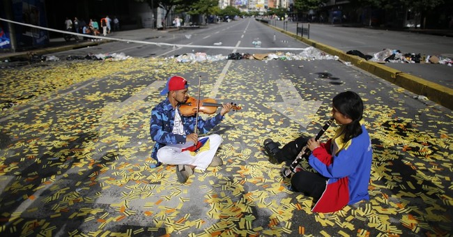Venezuelans begin 'final offensive' 24-hour walkout against President Nicolas Maduro