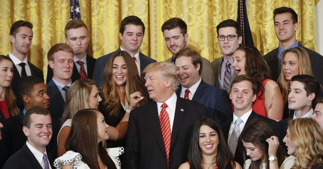 No, A White House Intern Didn't Throw Up A White Power Sign In Photo Op With Trump