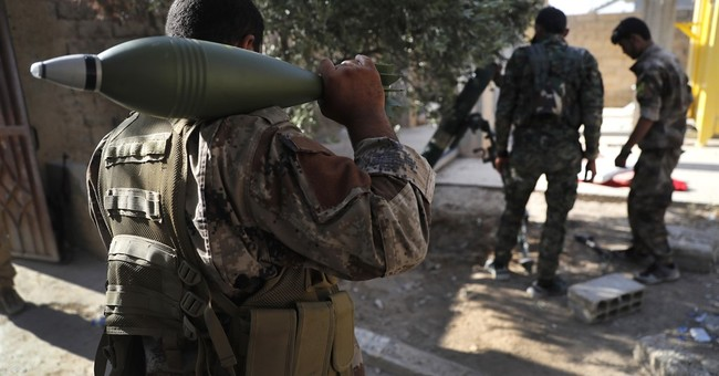 Syrian Forces Hold Almost Half of ISIS 'Capital'