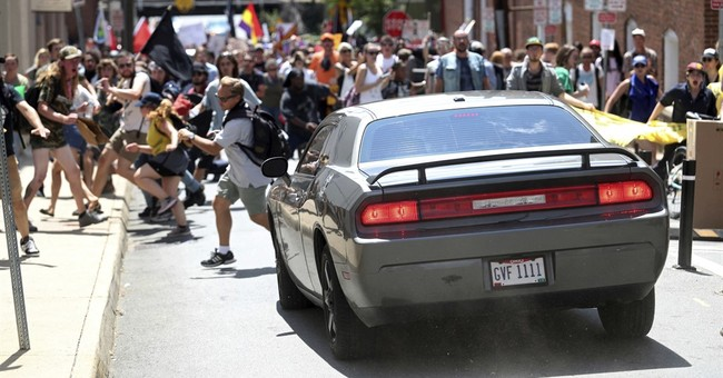 awful  one dead after car plows into counter demonstrators