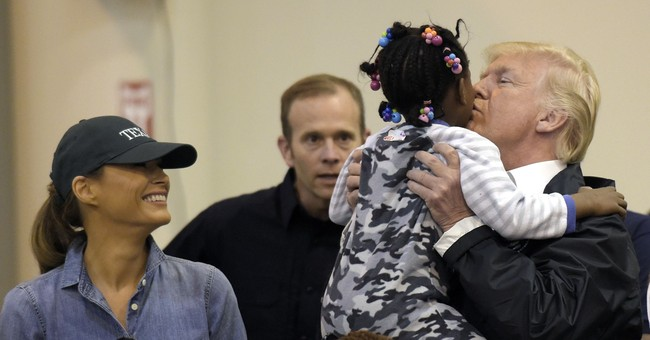 Trump, First Lady Hug Children, Serve Meals to Harvey Victims