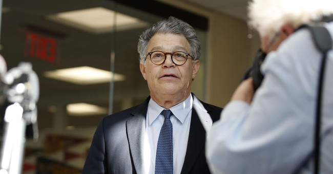 Sen. Al Franken denies allegation he forcibly tried to kiss woman
