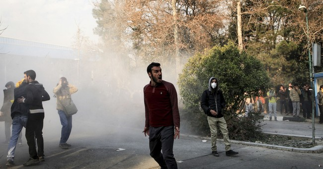 Iranians defy regime as wave of protest spreads
