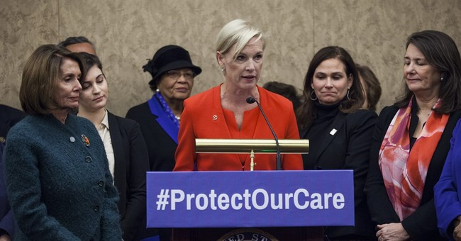 Hillary Clinton praises exiting Planned Parenthood leader