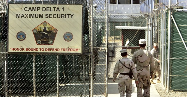 Trump signs order to keep Guantanamo open