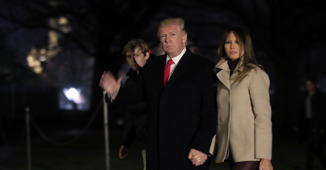 The Latest: Trump returns to White House after Florida break