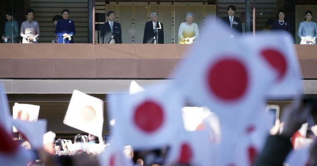 Japan's emperor greets cheering crowd at palace for new year