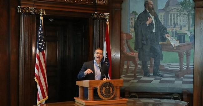 Missouri governor defies calls to resign