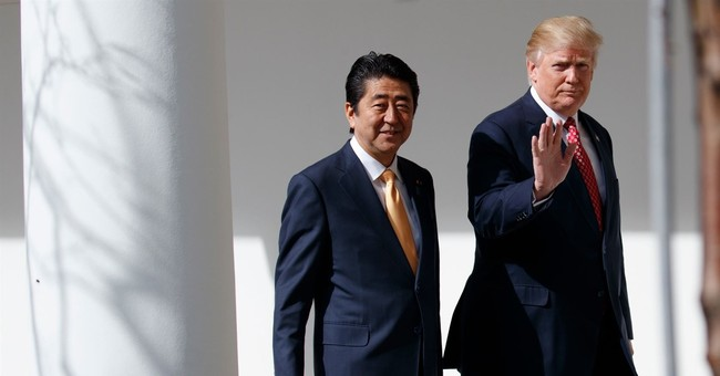 Japan's Abe to meet with Trump as scandals swirl at home