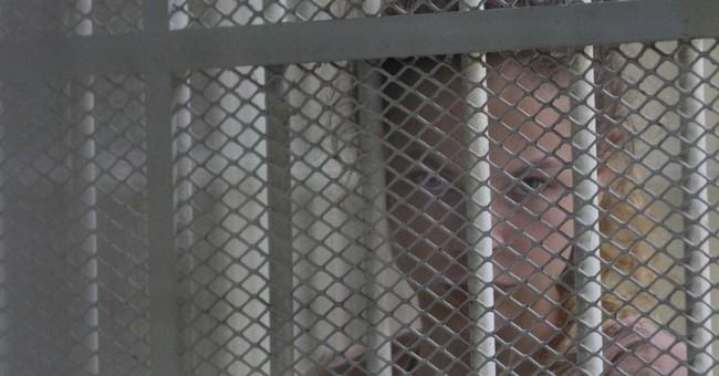Russian sex guru, follower blame US for continued detention