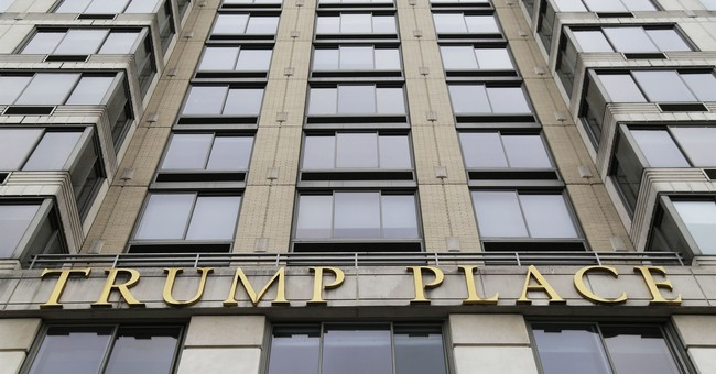 Trump-branded condo tower sues for right to erase his name