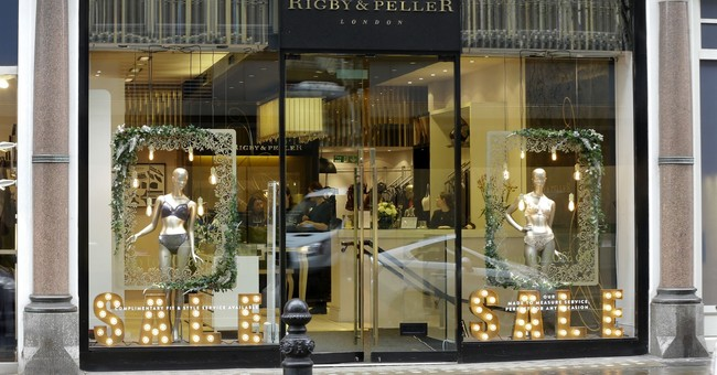 Queen's bra-fitter says book cost company royal warrant