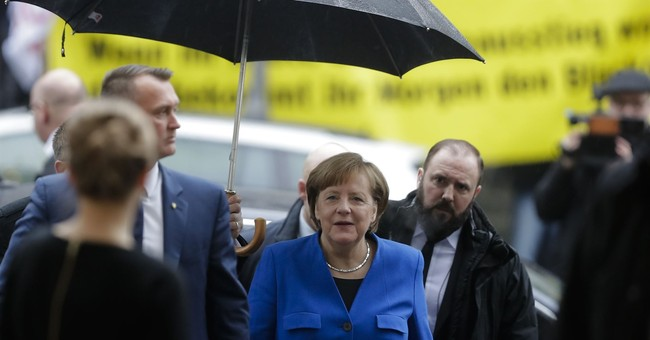 The Latest: France welcomes 'good news' from Germany