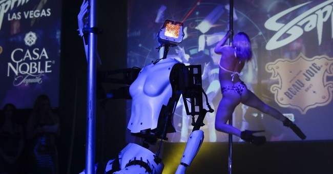 The Latest: What robot strippers say about sexism and tech