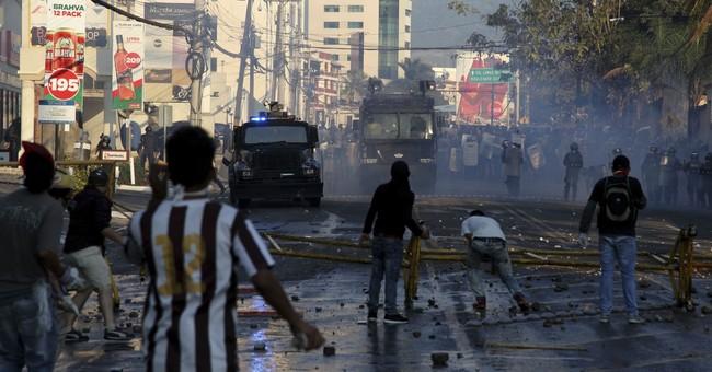 Protests against Honduran leader's re-election turn violent