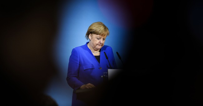 German center-left party battles over new Merkel coalition
