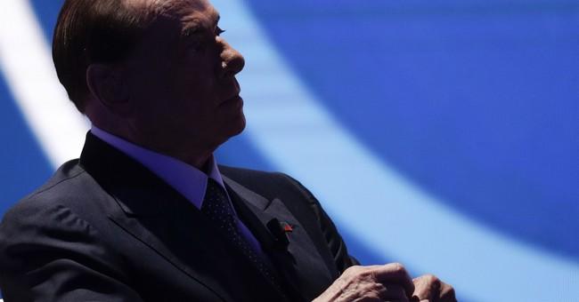 Italy ex-leader Berlusconi backs Deneuve on male courtship