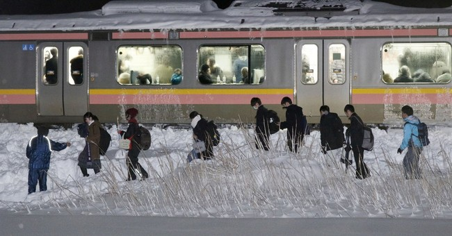 Heavy snow strands 430 people overnight on train in Japan