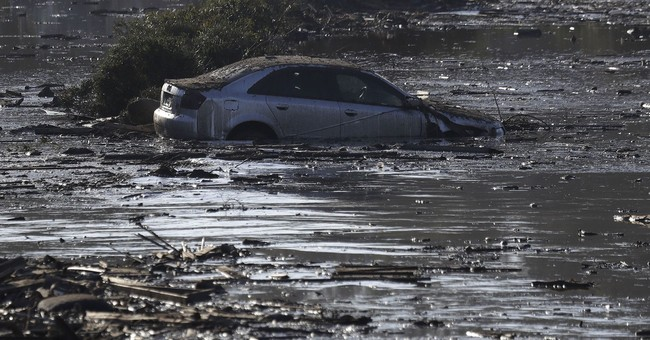 The Latest: Man thought found after mudslide still missing