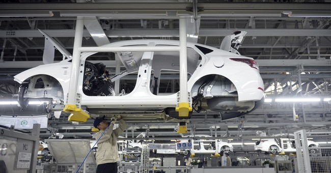 China auto sales shrink in December, end year up 1.4 percent