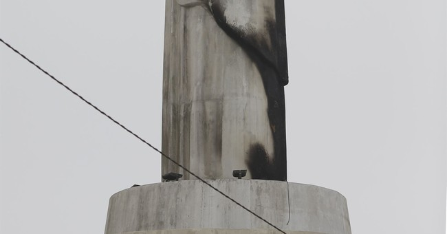 Christ statue in Peru damaged by fire days before pope visit