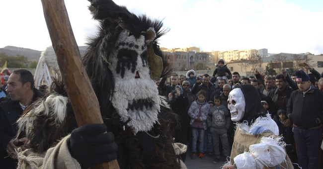 AP PHOTOS: Wild costumes, drums mark Algerian New Year fest
