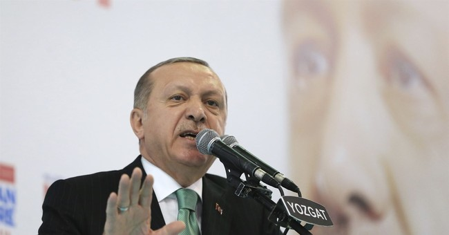 The Latest: Turkey's Erdogan to 'drown' Syrian Kurdish force