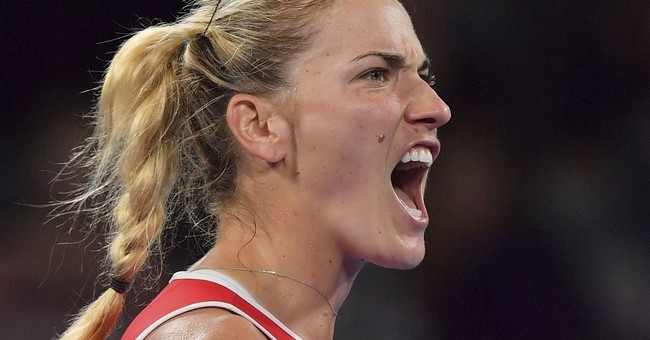 The Latest: Falconi loses, ends forgettable day for US women