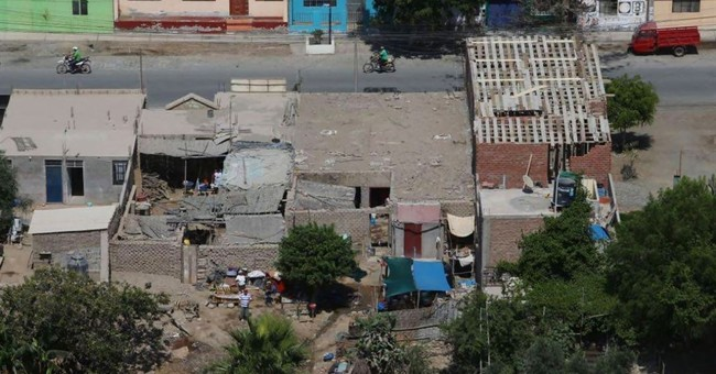 The Latest: Peruvian quake destroys 63 homes, kills 1 man