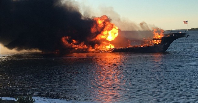 The Latest: Passenger who died after boat fire identified