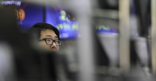 Asian markets higher as US, China put trade war on hold