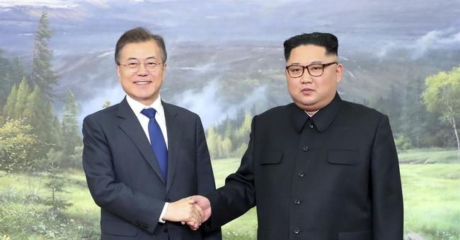 """The Latest: Trump says Korea talks """"going along very well'"""