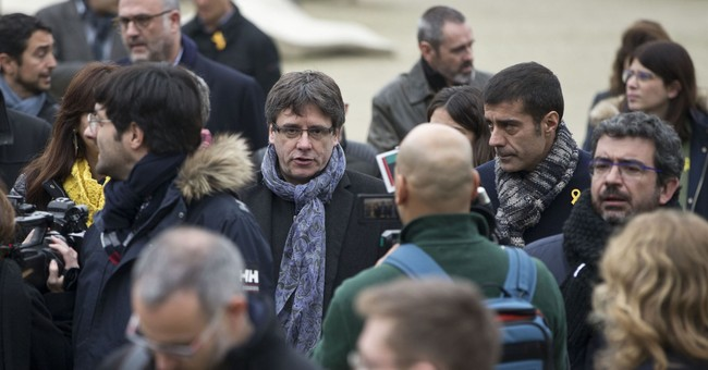 Spain warns Catalan leader against swearing-in from Brussels