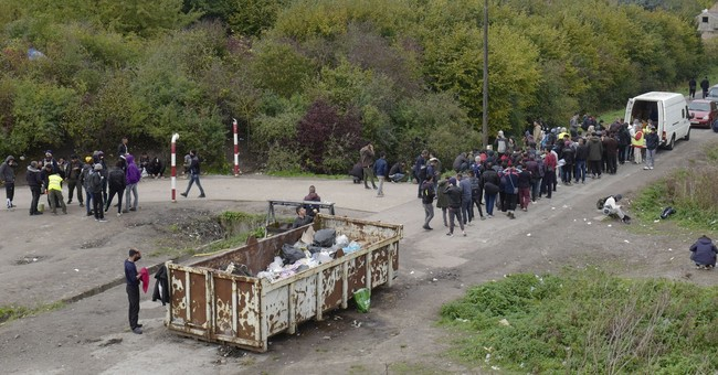 The Latest: Macron wants quick action on UK-bound migrants