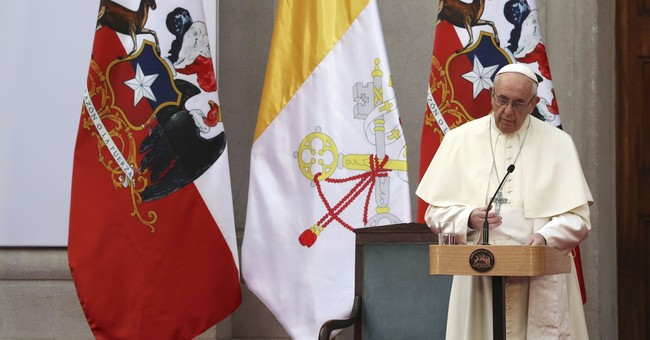 The Latest: 3 churches firebombed in Chile during pope visit