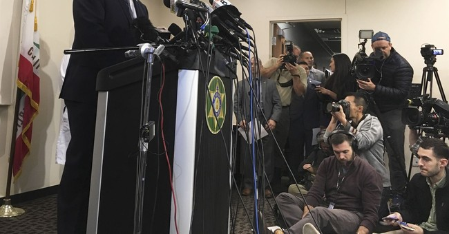 The Latest: Officiant: Captive kids, parents seemed normal