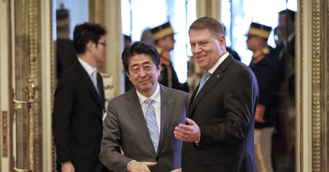 Japanese PM lands in Romania as leader he is to meet resigns