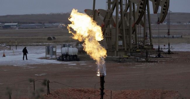 North Dakota oil output cut back to meet gas capture rules