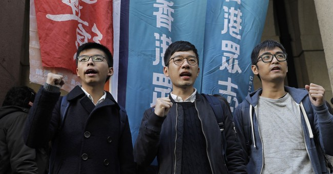 Young Hong Kong activists in court to appeal prison terms