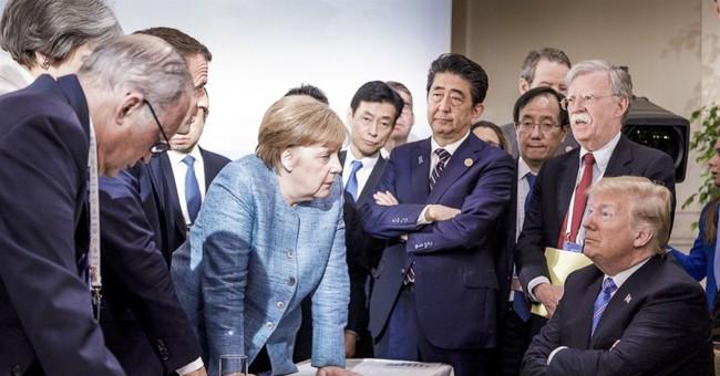 Trump, Trudeau swap jokes but hold firm in trade dispute class=