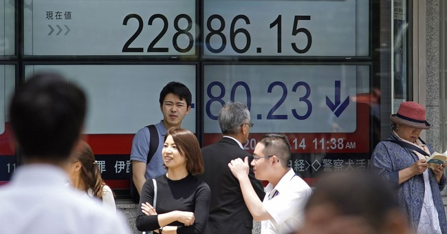 Global stocks sink after Fed hike signal, eyes turn to ECB
