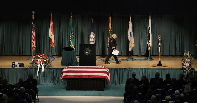 Procession, memorial honors slain Washington state deputy