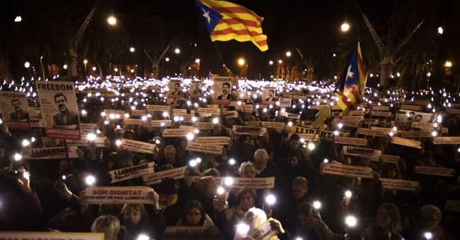 Catalan parliament reconvenes, elects pro-secession speaker